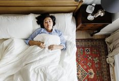 Asian woman on the bed sleeping by herself Royalty Free Stock Image