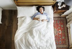 Asian woman on the bed sleeping by herself Stock Photo