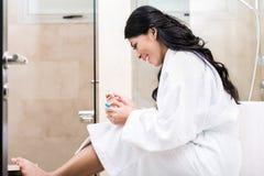 Asian woman being joyfully pregnant Stock Photo