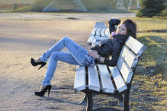 Asian woman on bench. Beautiful asian woman sitting on bench stock images