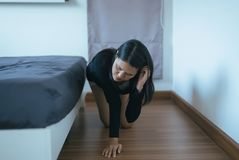 Asian female bent and searching something under bed lost thing in bedroom. Asian woman bent and searching something under bed lost thing in bedroom stock photos