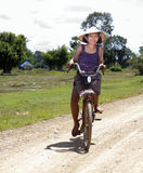 Asian woman on a bicycle Royalty Free Stock Images