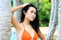 Asian woman in a bikini. Royalty Free Stock Photo