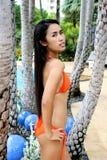 Asian woman in a bikini. Stock Images
