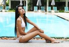 Asian woman in a bikini. Stock Photos