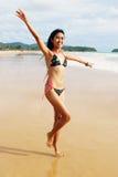 Asian woman in a bikini. royalty free stock photos