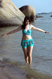 Asian woman in bikini lean on the summer beach Stock Photography
