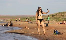 Asian woman bikini selfie picture at beach Royalty Free Stock Photo