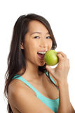 Asian Woman biting an apple Royalty Free Stock Image