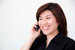 Asian woman in black shirt with telephone Stock Photo