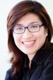 Asian woman in black shirt wearing glasses Stock Photo