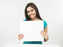 Asian woman with a blank placard. A pretty asian woman with a blank placard stock photography