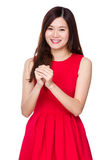 Asian woman with blessing sign for Chinese new year. Isolated on white background