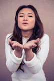 Asian woman blowing kiss Stock Photos