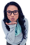 Asian woman blowing kiss to the camera Royalty Free Stock Photo