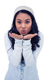 Asian woman blowing kiss to the camera Royalty Free Stock Photography