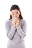 Asian woman blowing warm air from her mouth to her hand Stock Images