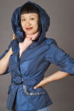 Asian Woman in Blue Hooded Coat Stock Image