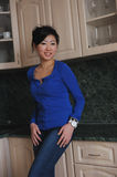 Asian woman in blue shirt Stock Photography