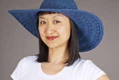 Asian Woman in Blue Straw Hat Stock Photography
