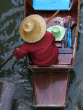 Asian woman in a boat. On a river stock images
