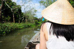Asian woman in a boat in Vietnam Royalty Free Stock Photography