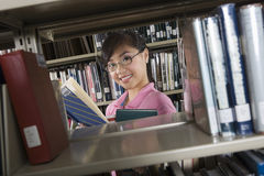Asian Woman With A Book In Library Stock Images