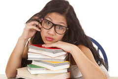 Asian woman on books glasses Stock Image