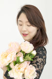 Asian woman with bouquet of flowers Stock Images