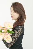 Asian woman with bouquet of flowers Stock Photos