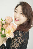 Asian woman with bouquet of flowers Stock Image