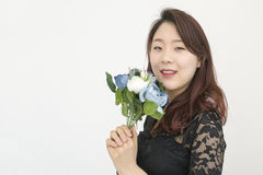 Asian woman with bouquet of flowers Royalty Free Stock Images