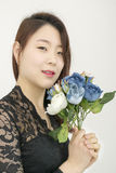 Asian woman with bouquet of flowers Royalty Free Stock Photo
