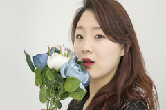 Asian woman with bouquet of flowers Royalty Free Stock Photos