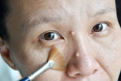 Asian woman brush on her face Royalty Free Stock Images