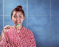 Asian woman brushing her teeth Stock Photography