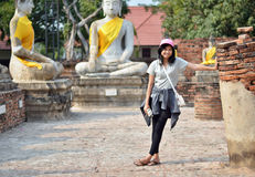Asian woman and buddha at Wat Yai Chai Mongkol Temple. Ayutthaya Royalty Free Stock Images