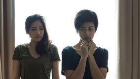 Asian woman bully and showing hate another girl stock images