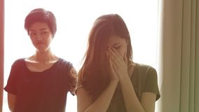 Asian woman bully and showing hate another girl royalty free stock photo