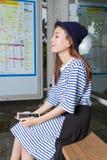 Asian woman at bus stop Royalty Free Stock Photography