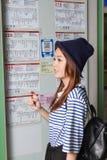 Asian woman at bus stop Royalty Free Stock Photo