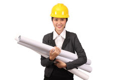 Asian woman in business engineering wear holding large rolls of drawings Royalty Free Stock Photo