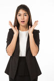 Asian Woman in business formAsian woman in business formal black suit  acting surprise. A portrait of an Asian women in business formal black suit  acting Stock Image
