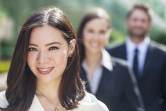 Asian Woman Businesswoman Interracial Business Team. Beautiful Asian Business women and interracial group of business men & women, businessmen and businesswomen royalty free stock image