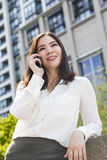 Asian Woman or Businesswoman Talking on Cell Phone Royalty Free Stock Photos