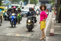 Asian woman on a busy highway Stock Images
