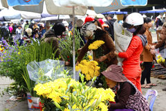 Asian woman buying flowers in the market Royalty Free Stock Photos