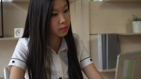 Asian woman buys in online store stock video footage