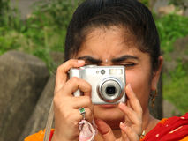 Asian woman with camera Royalty Free Stock Photography