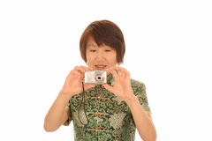 Asian woman with camera Royalty Free Stock Photos